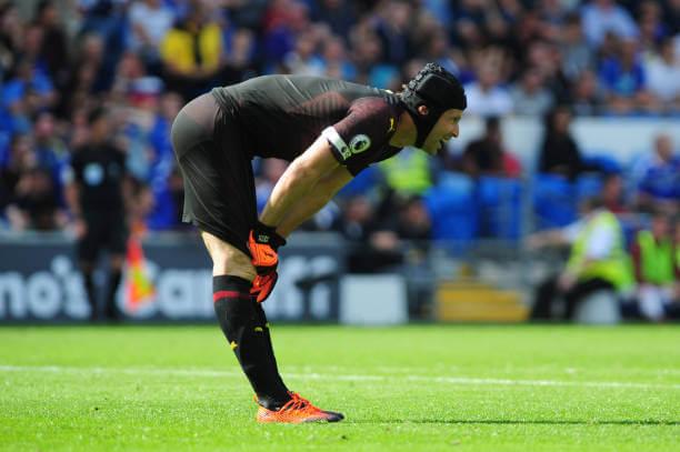 Petr Cech bent over